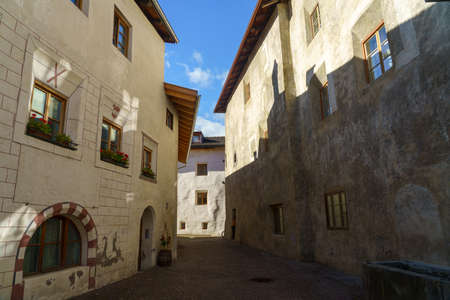 Glorenza, or Glurns, Bolzano, Trentino Alto Adige, Italy: historic city in the Venosta valley. Old street at morning Archivio Fotografico