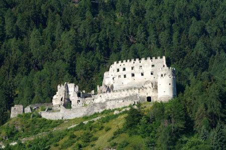 Mountain landscape along the road from Glorenza to Prato allo Stelvio, Bolzano province, Trentino Alto Adige, Italy, in the summertime. Ruins of castle