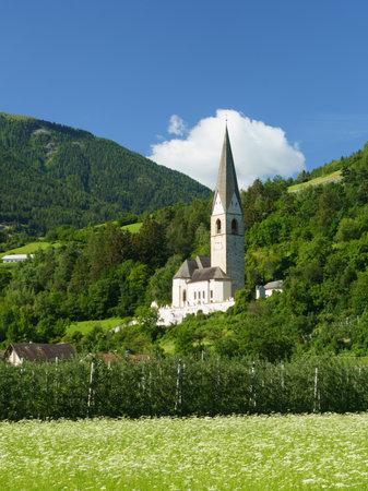 Mountain landscape along the road from Glorenza to Prato allo Stelvio, Bolzano province, Trentino Alto Adige, Italy, in the summertime. Church