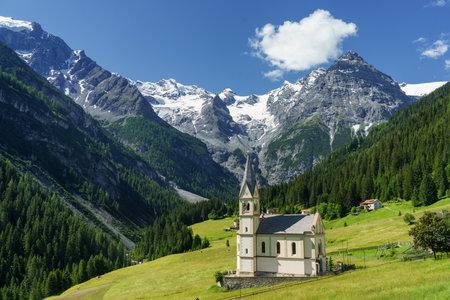 Mountain landscape along the road to Stelvio pass, Bolzano province, Trentino-Alto Adige, Italy, at summer. Church