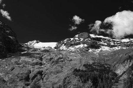 Mountain landscape along the road to Stelvio pass, Bolzano province, Trentino-Alto Adige, Italy, at summer. Black and white