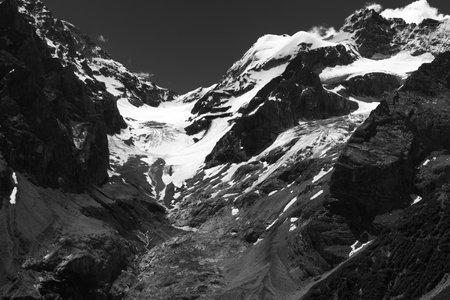 Mountain landscape along the road to Stelvio pass, Bolzano province, Trentino-Alto Adige, Italy, at summer. Glacier. Black and white Archivio Fotografico