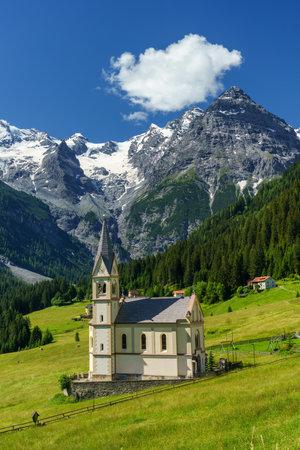 Mountain landscape along the road to Stelvio pass,  Trentino-Alto Adige, Italy, at summer. Church