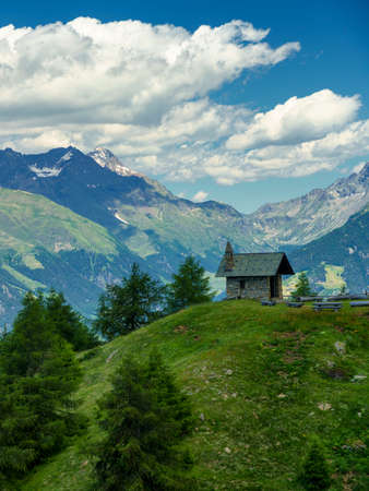 Mountain landscape at summer along the road from Mortirolo pass to Aprica, in Sondrio province, Lombardy, Italy