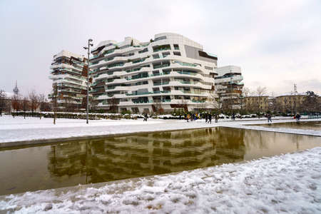 Milan, Italy: the modern Citylife park with snow