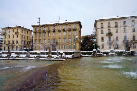 Milan, Italy: the modern Citylife park with snow. The fountain of Four Seasons