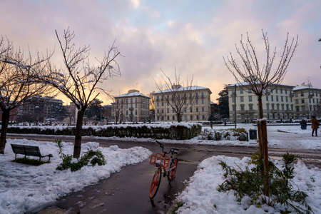Milan, Italy: the modern Citylife park with snow. A bicycle Archivio Fotografico