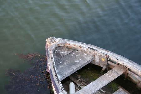 monterey: old rustic wooden boat in monterey california
