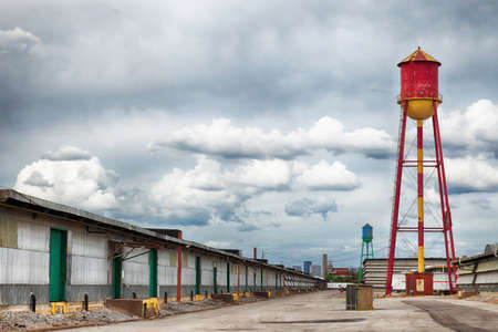 abandoned warehouse: Water Towers in Warehouse District Stock Photo