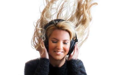 Hurl: Pretty Girl Flinging Hair Listening Headphones Isolated Background