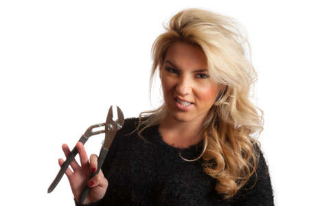 snarling: Pretty Blonde Snarling Mean Face Holding Pliers Isloated Background