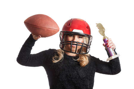facemask: Pretty Blonde Celebrating Red Helmet Throwing Football Stock Photo