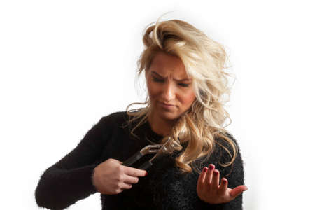 befuddled: Pretty Blonde Confused Trying To Cut Hair with Pliers