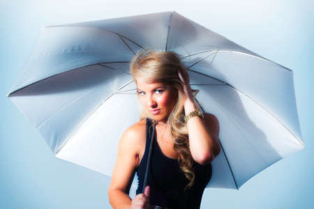 slicker: Blonde Latina girl holding umbrella. Stylized silver and blue