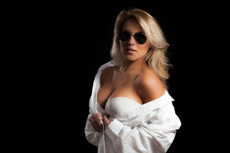A blonde Latina girl in aviator sunglasses and a white mean