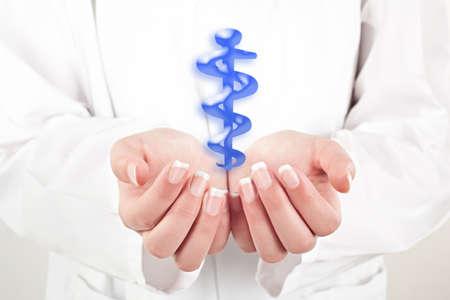 doctor woman holding health symbol in her hands Standard-Bild