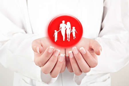 ministration: family with the protection of  hands, concept for security and care  Stock Photo
