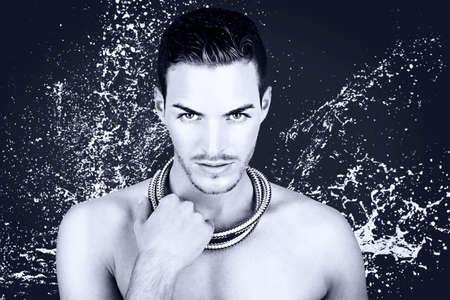 beautiful young man taking a shower