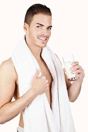 Beautiful man drinking milk