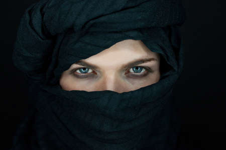 eyes of a beautiful man with black scarf