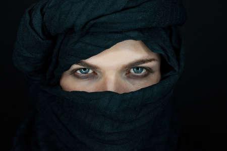 burka: eyes of a beautiful man with black scarf