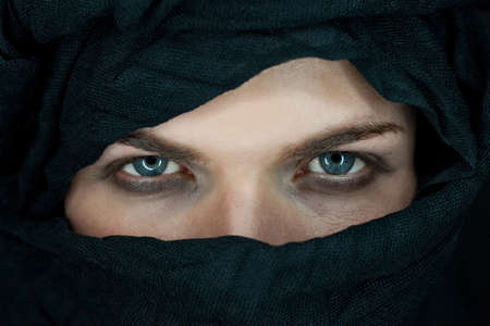 nomad: eyes of a beautiful man with black scarf
