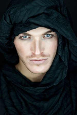 beautiful man with black scarf Stock Photo