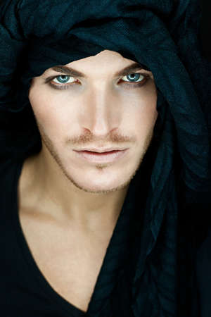 beautiful man with black scarf Standard-Bild