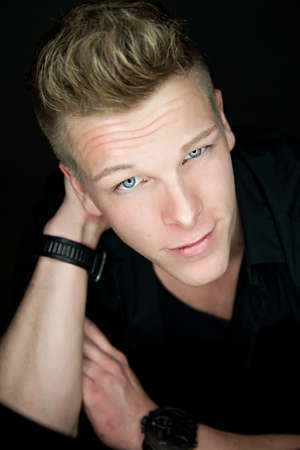 Portrait of a beautiful young blond man