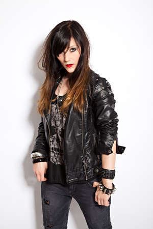 lascivious: portrait of a beautiful young woman with leather jacket