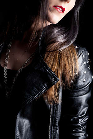 portrait of a beautiful young woman with leather jacket photo