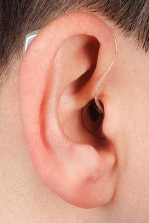 aural: ear with acoustic instrument