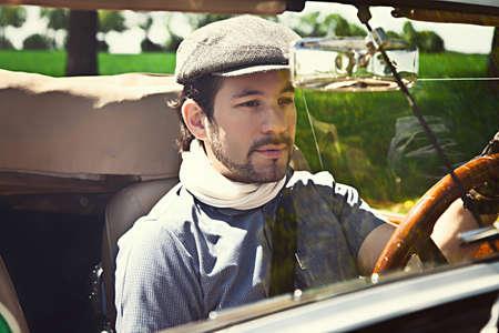 Retro man behind steering wheel photo