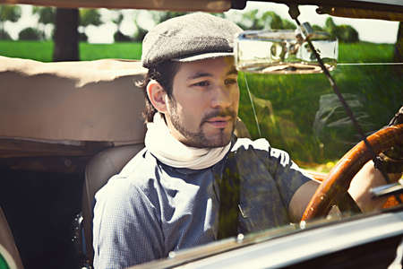 Retro man behind steering wheel Stock Photo - 20330672