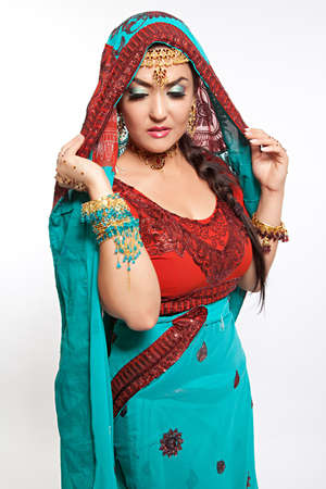 Beautiful young indian woman in traditional clothing photo