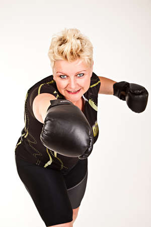 middelaged fitness woman boxing wearing boxing gloves and having fun photo
