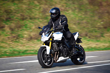 cornering: Motorcyclist biker on the road