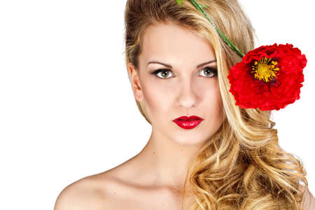 Beauty Blonde Woman. Beautiful girl with long curly blond hairand red flower