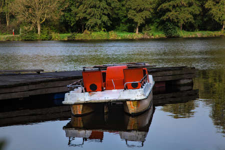 empty pedal boats in autumn