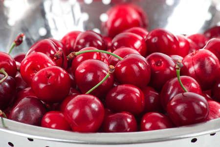 Fresh ripe sweet tasty cherries in a colander Stock Photo