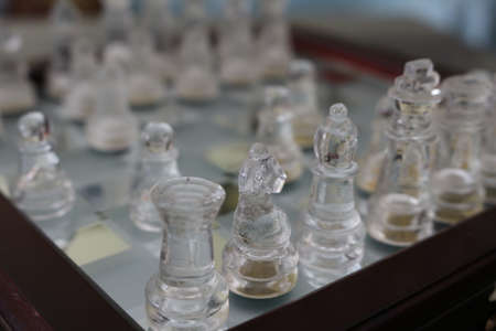 Chessboard and chess game pieces.