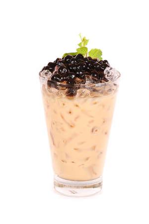 Iced milk tea isolated on white background photo