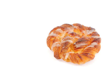 calorific: sweet spiral bun isolated on white background