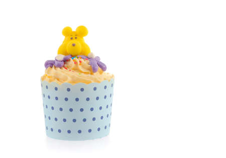 Cupcake with buttercream icing isolated on white background photo