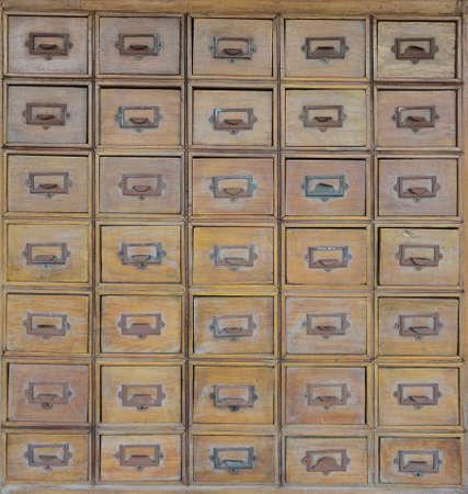 Rows of old wood drawers photo