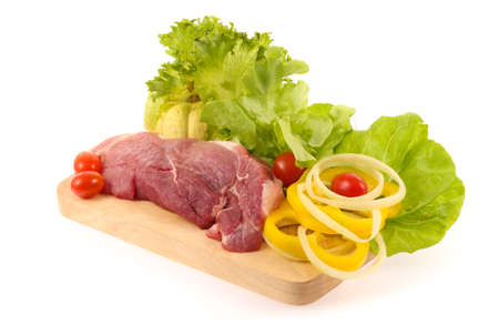 raw pork meat  with vegetable on chopping block isolated on white background Stock Photo