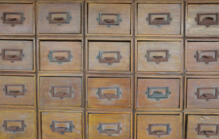 Rows of old wood drawers