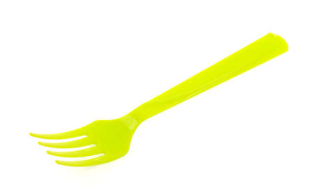 housewares: Green plastic fork isolated on white background