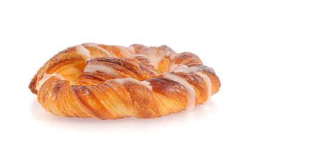 calorific: sweet spiral bun isolated on white background