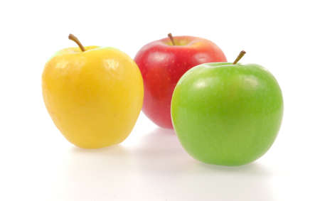 yellow apple: Yellow green and red apples isolated on white background
